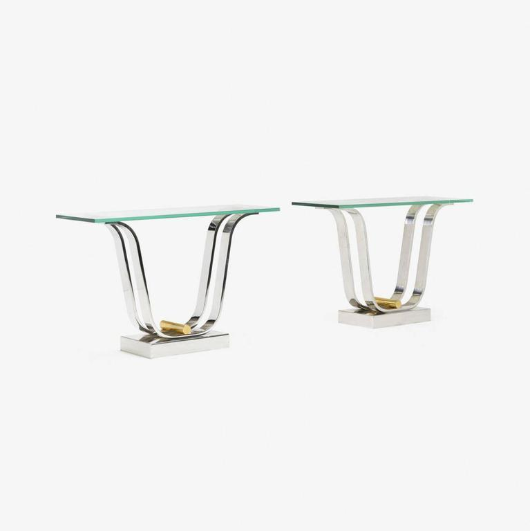 Pair of authenticated tulip table bases designed and manufactured by Karl Springer, Ltd. The bases are currently reconfigured as a pair of console tables with glass tops, but they can also be used as dining table bases to support a large glass top.