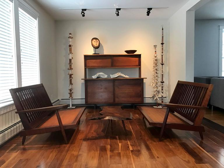 Two single arm walnut settee in a rare sectional configuration, custom-made and gifted to a family friend, circa 1950s by George Nakashima in his New Hope Studio. The two settees can be used as an opposing pair, a L-shape configuration or a very