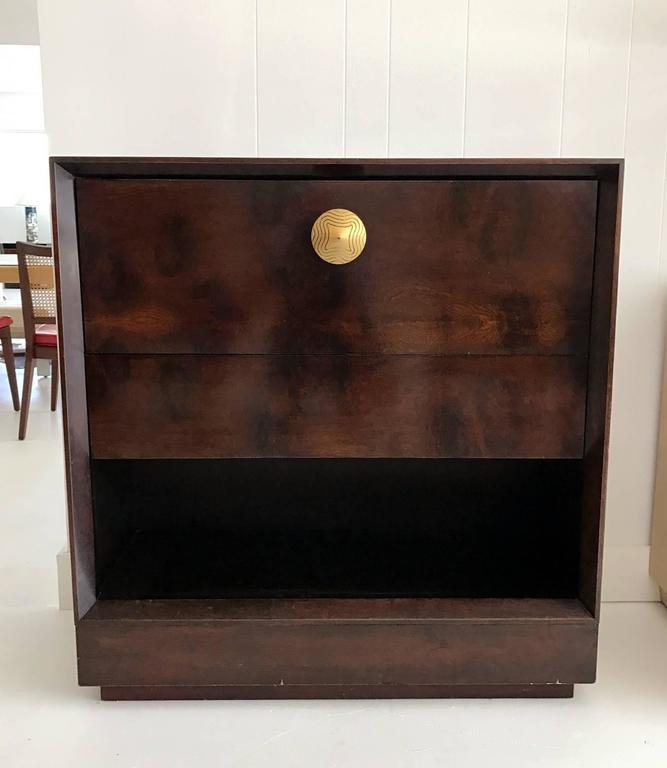 Art Deco transiting to Streamline modern drop front desk/secretary designed by Gilbert Rohde in 1940s and manufactured by Herman Miller. Exotic paldao veneer. It has a draw and a drop front desk with fitted interior. The knob on the front of the