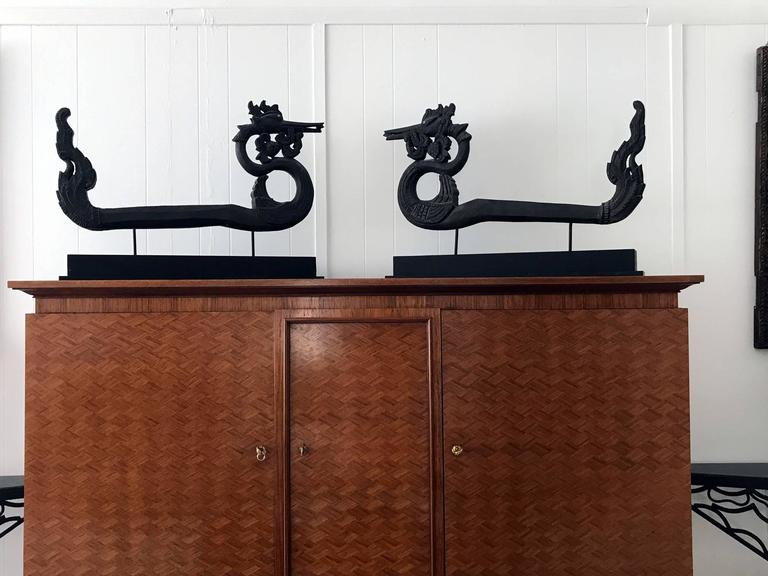 This pair of large wood carvings was used to decorate the ox carts that were widely used in Burma. They were carved and constructed in the shape of the bird Hong. Hong is a mythical bird of infinite grace. As an auspicious creature, it symbolizes