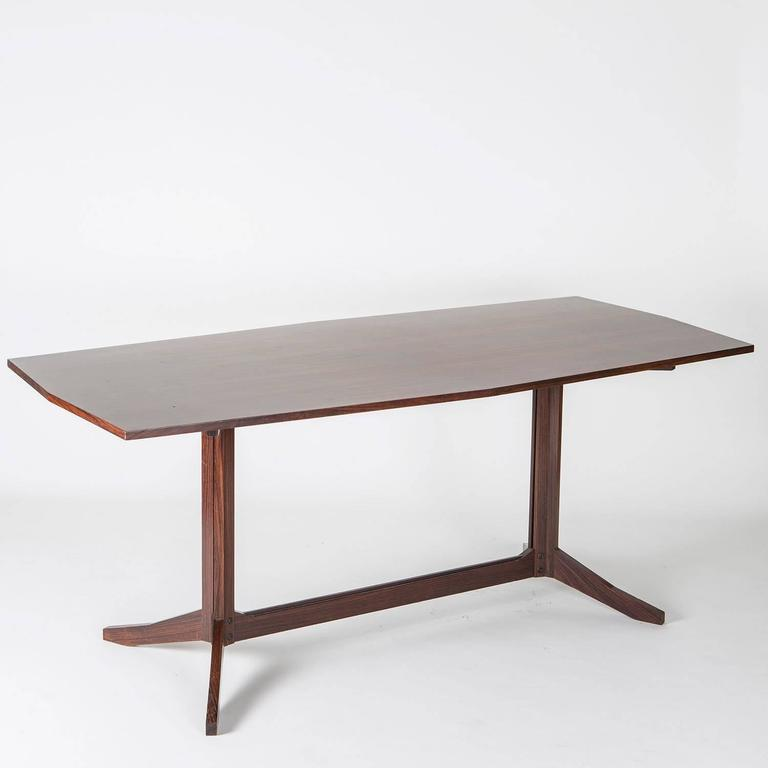 Remarkable rosewood table manufactured by Poggi.