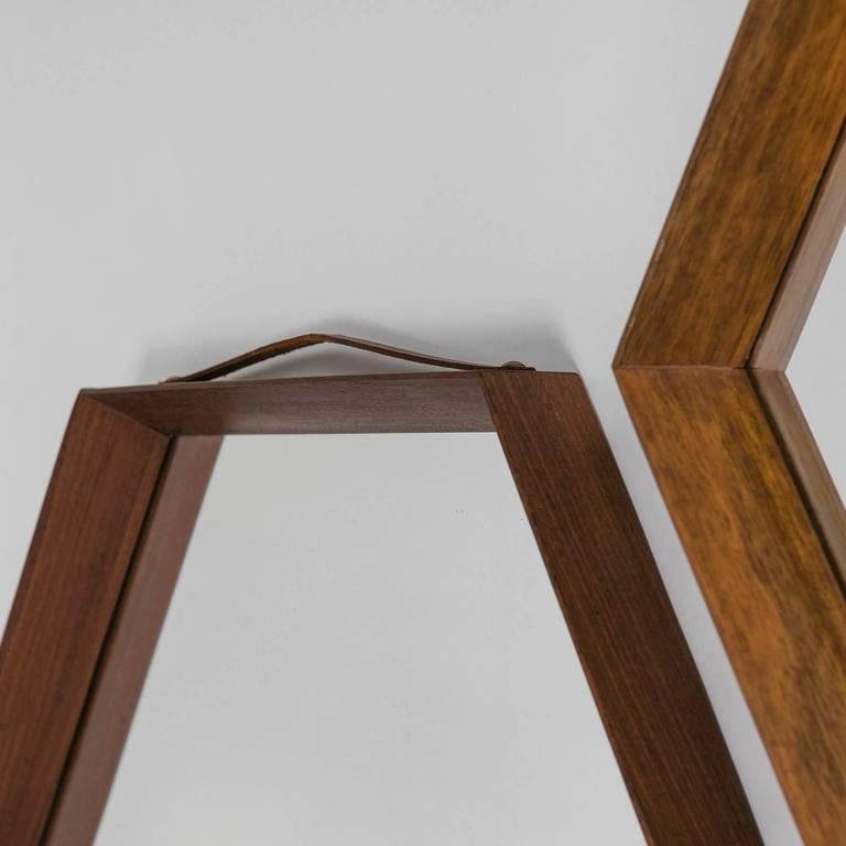 Rare set of two hexagonal Italian mirrors with teak frame.