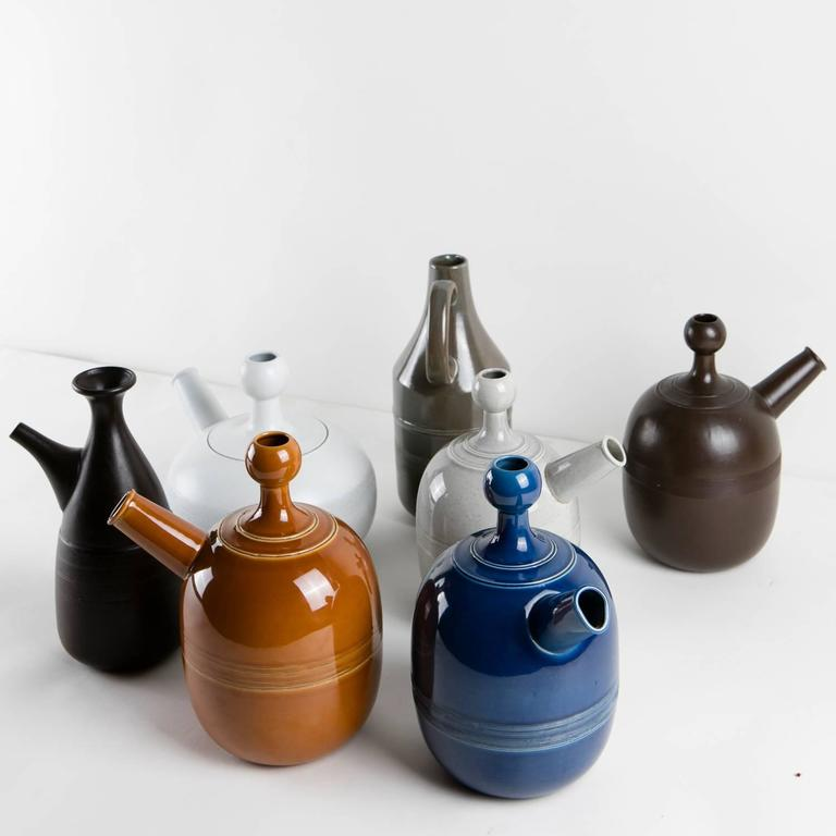"""Remarkable group of seven carafes by Ambrogio Pozzi for Ceramiche Franco Pozzi. Collection designed in 1966 with the influence of Tapio Wirkkala works and for Zen symbolism. Enamel colors. Pieces displayed as part of the exhibition """"Arts & Foods"""""""