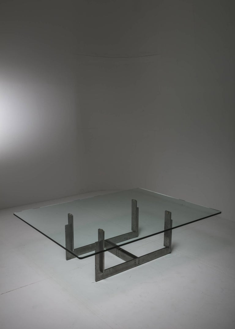 Remarkable Sarpi low table by Carlo Scarpa for Simon. Small-scale architecture with drawn brushed metal frame held together with visible burnished screws.