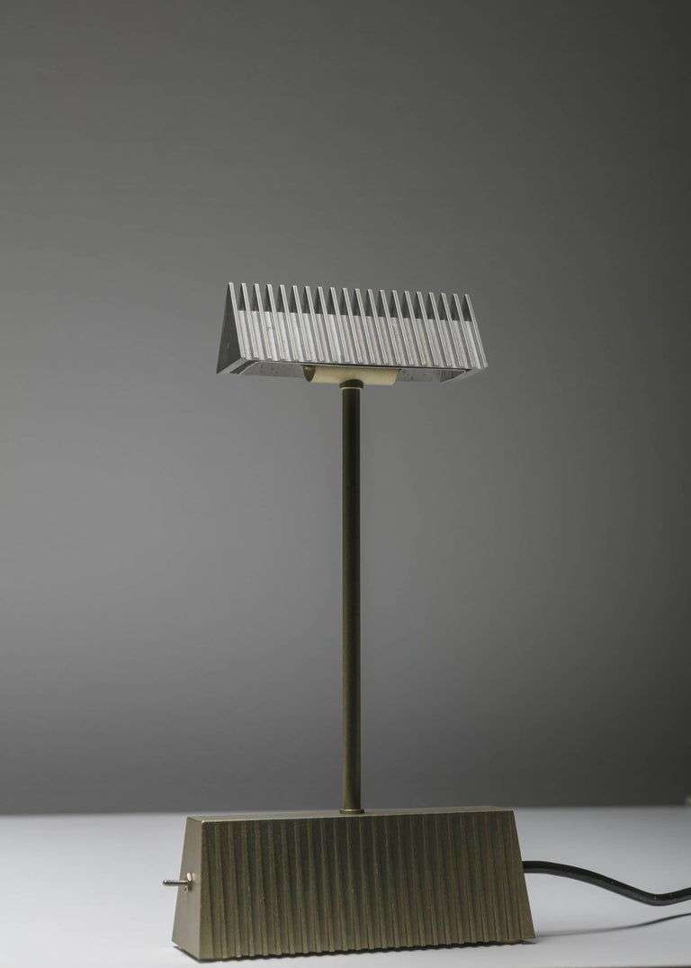 Scintilla table lamp by Livio and Piero Castiglioni for Fontana Arte. Tiny and Minimalist bicolored halogen lamp with double light intensity.