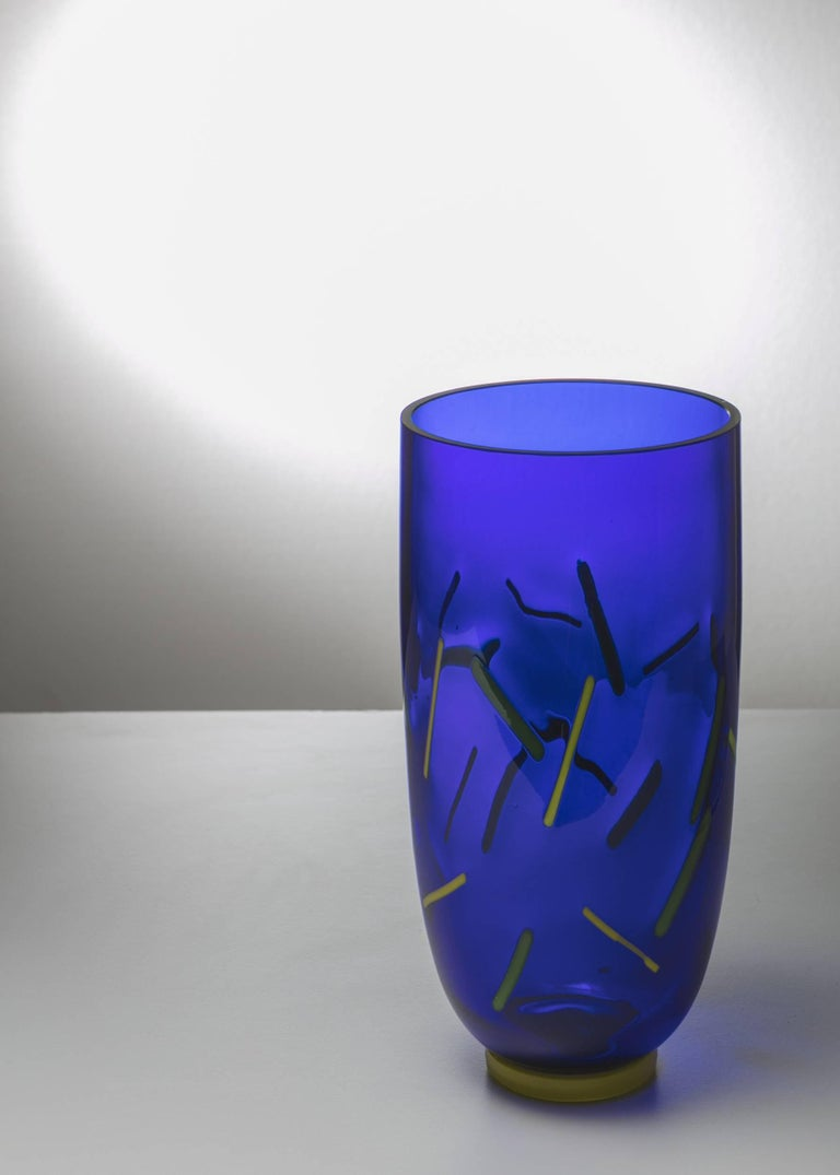 Remarkable Murano glass vase by Barovier and Toso. Blue body with yellow and green inclusions.