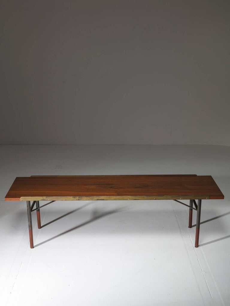 Bench or low table by Finn Juhl for Bovirke. Wood top with brass rims supported by an architectural wood and metal structure.