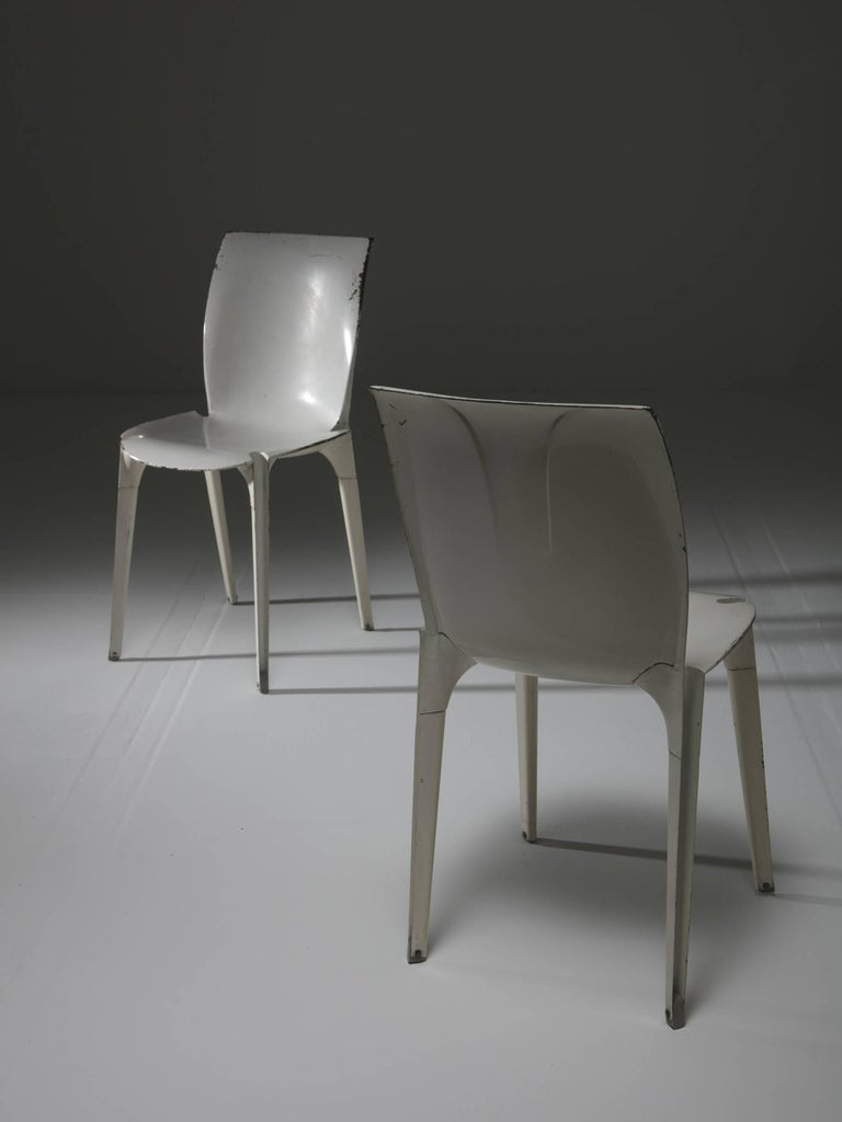 Set of two Lambda chairs by Richard Sapper and Marco Zanuso for Gavina. Extreme Industrial-Design research for this piece generated by two steel sheets joined together. Incredibly compact and comfortable seat.