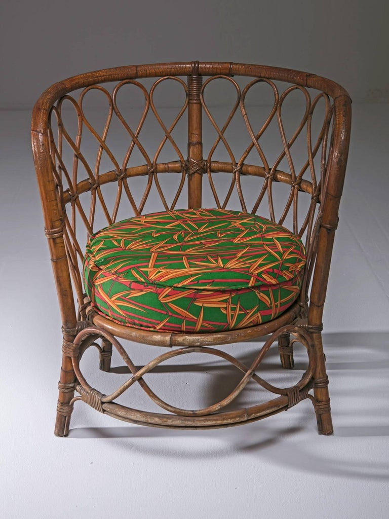 Compact wicker chairs with original upholstery.