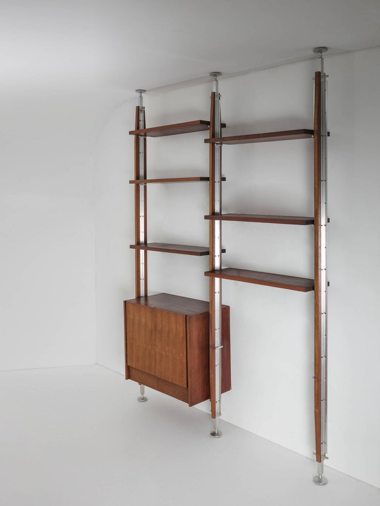 Remarkable bookcase with steel and wood frame.