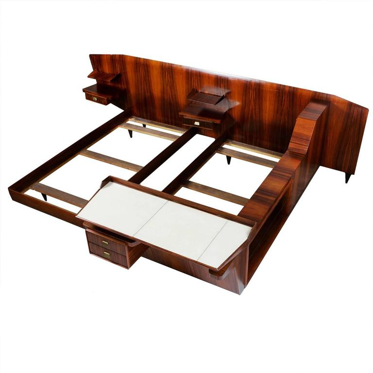 Important and unique double bed by Gio Ponti executed by Egidio Proserpio, Barzano'. Rosewood bed with asymmetrical