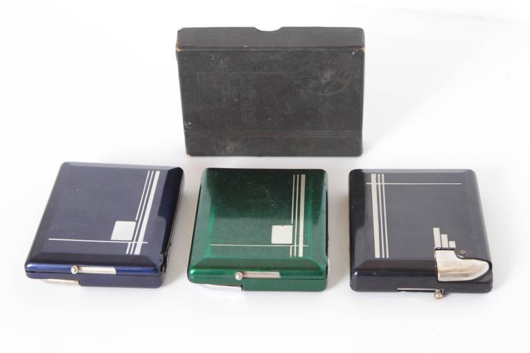 Machine Age Art Deco Magic Case Automatic Cigarette Case and Lighter   Modernist  Streamline  Industrial Design  All three known colors: black, blue & green.  One original box Original mechanical design patents from 1914 & 1918;  Emmanuel Dobrowski,