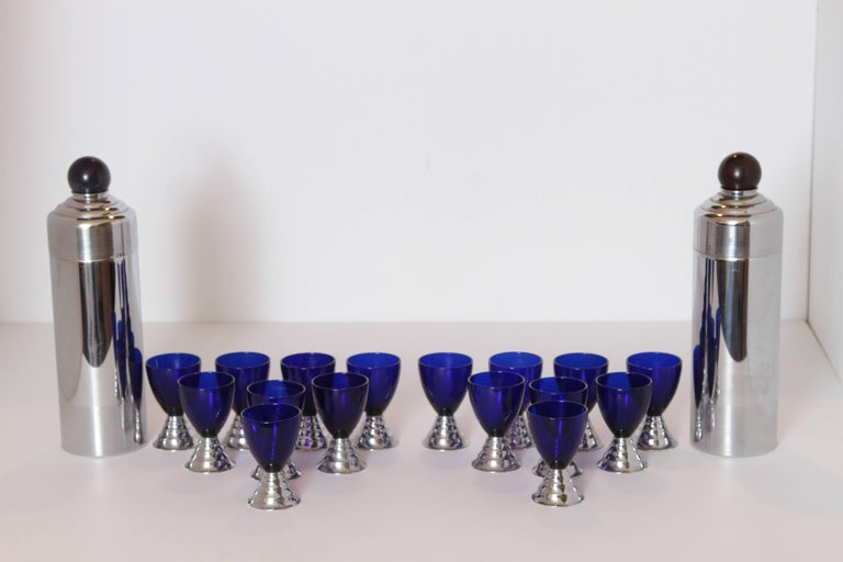 Pair of sets, PRICED PER SET  Machine Age Art Deco Chase Chrome Blue Moon Cocktail Sets  Pair  Removable deep amethyst Catalin jigger tops. Integral strainer in top caps. Nice cobalt/chrome cups. Excludes ring tray. Sets are in good vintage used