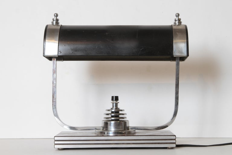 Machine Age Art Deco Markel table lamp Rectangular-tube arm design with multiple Von Nessen - like rings. Iconic Markel ringed finials. Aluminum base banding with incised lines. Oxblood Bakelite laminated base.  Rewired with new switch at some