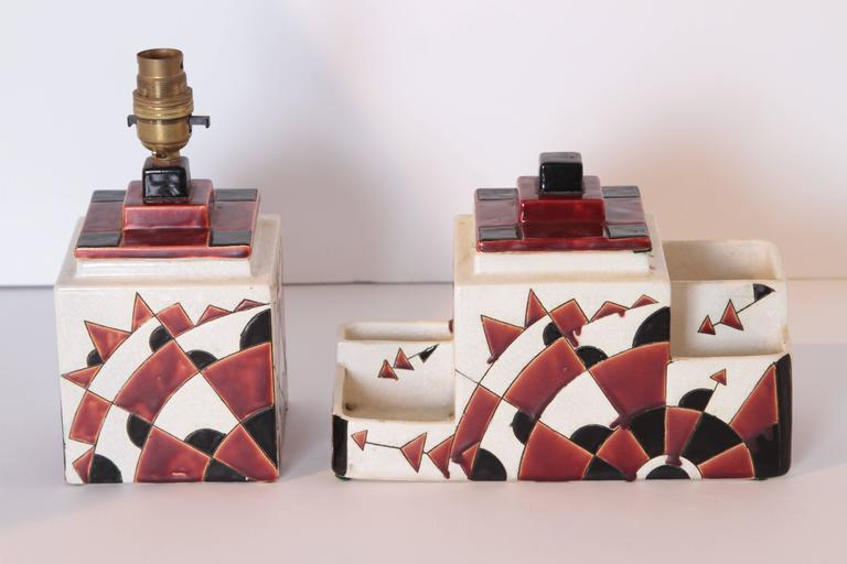 Art Deco Boch Freres Charles Catteau Belgian Cubist Keramis Ceramics, Desk Set  Rare matched pair lustrous polychromed skyscraper and gear designs by Charles Catteau, with excellent machine age geometric graphics. Multi-compartment, multi-level desk