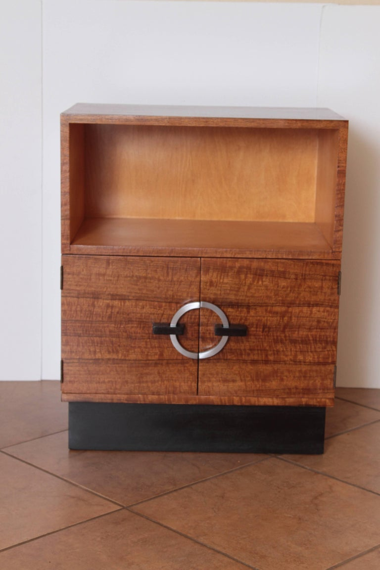 Art Deco Machine Age Gilbert Rohde Herman Miller, 1934 East India Laurel cabinet  One of the finest figured EIL pieces we have had. Terrific graining to the veneer on this one. Beautiful example of Rohde's groundbreaking modular design