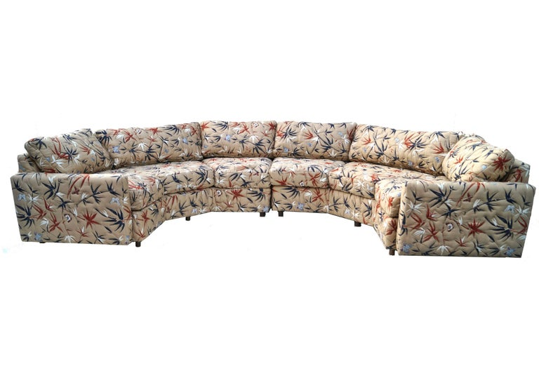 This beautiful mid-century modern two-piece sofa has three sides each when separated. When together it has 5 sides, not including the sides where the armrests go. It is a tan color with Black and rust bamboo and butterflies. Would go great with