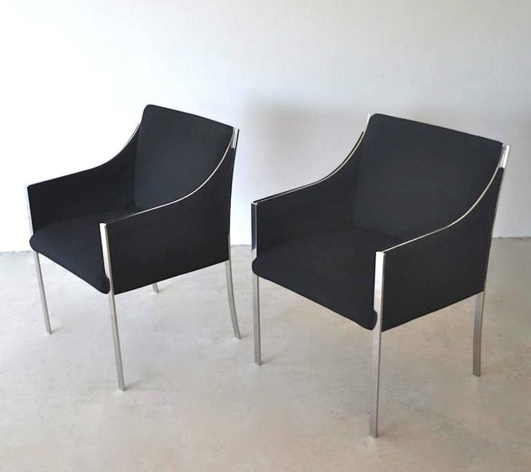 Pair of midcentury occasional chairs or lounge chairs by Jens Risom, circa 1960s. These sculptural armchairs/side chairs are upholstered in a black woven linen/wool fabric and accented with sleek chrome frames.
