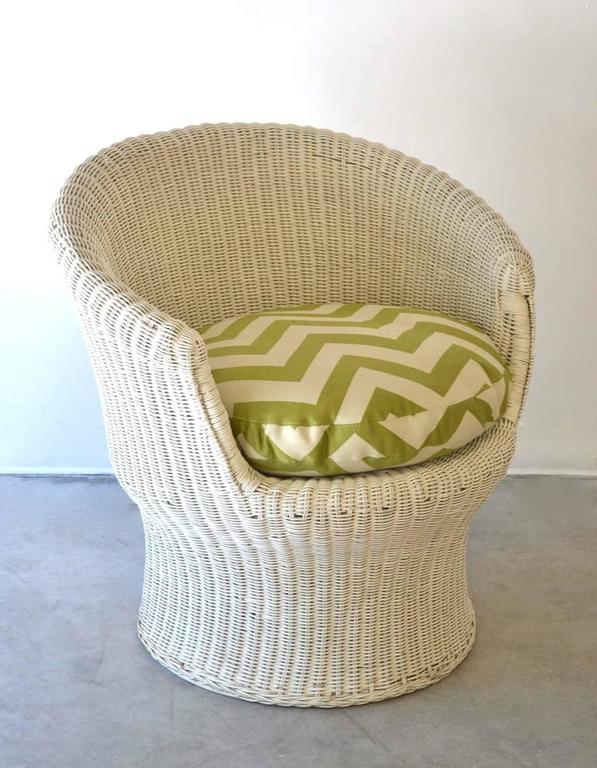 Sculptural midcentury French white lacquered woven rattan tub chair, circa 1960s. This striking side or occasional chair with down cushion is upholstered with a green and white chevron print cotton fabric.
