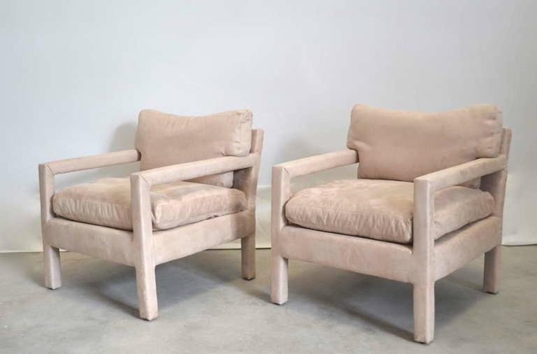 Sculptural pair of Mid-Century Parsons style down cushioned club chairs, circa 1960s-1970s. These striking elegant armchairs/lounge chairs are upholstered with down cushions in a natural cotton fabric in excellent condition.