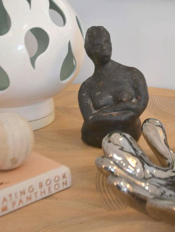 Striking hand thrown ceramic sculpture, circa 1950s-1960s. This midcentury sculpture of a female figure is organic in form with a subtle volcanic glaze.