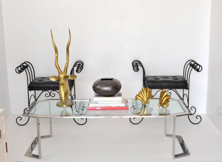 Stunning Postmodern chrome and brass coffee table, circa 1970s-1980s. This glamorous artisan crafted cocktail table is designed with a sleek chrome frame contrasted with a polished brass stepped surround and accented with an inset glass top.
