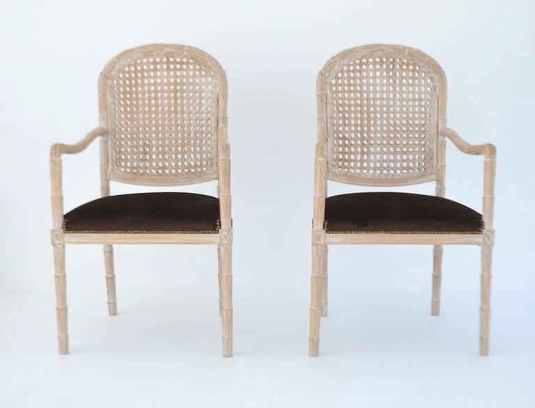 Elegant pair of hand-carved Italian hall chairs or occasional chairs by Carlo Boffi, circa 1950s-1960s. These stunning side chairs or armchairs of white washed hardwood in a Classic overall hand-carved laurel leaf design with caned backs and