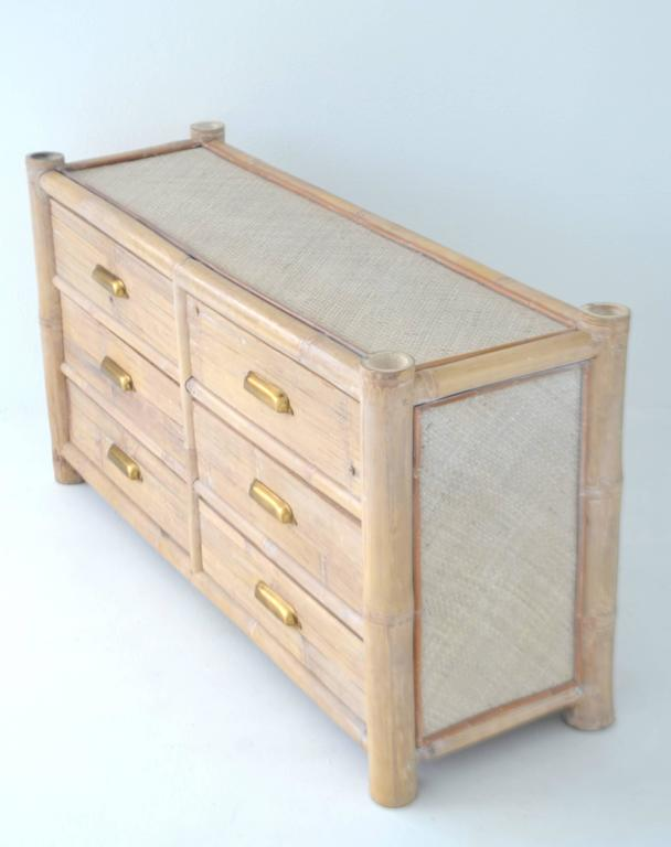 Striking cerused bamboo sideboard, circa 1970s. This custom made credenza/buffet is designed of cut reed, woven rattan and accented with brass hardware.
