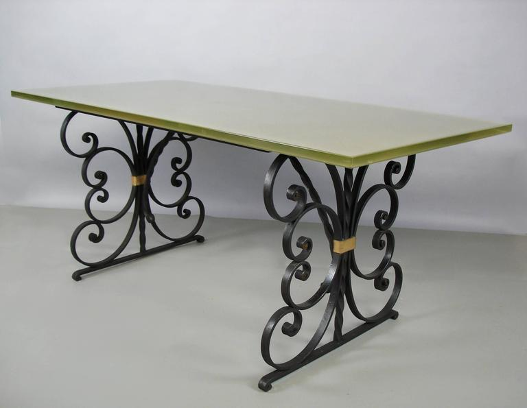 7c05be0953dd A black painted and gilt wrought iron structure supporting a glass top. The  glass is