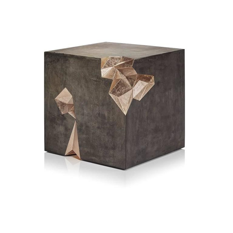 Monolith is a concrete and gold leaf stool or side table designed by Harow Studio.