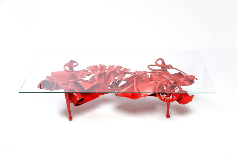 The unique coffee table design by world renowned sculptor and metalworker Albert Paley is the first piece from his new body of work, Convergence: Color and Form. High-lead glass top is available separately.  Albert Paley (born 1944) is an American