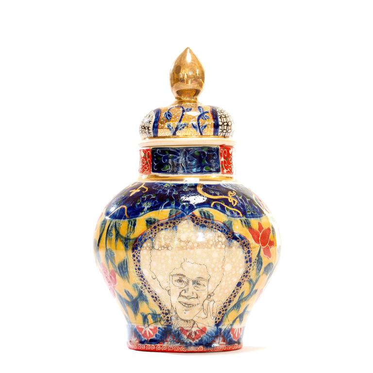Whitney Houston / Shirley Chisholm Urn is made by Roberto Lugo out of porcelain, china paint and gold luster.  Best known for expertly thrown ceramic vessels that are illustrated with activists, political figures, and hip-hop legends, Lugo aims to