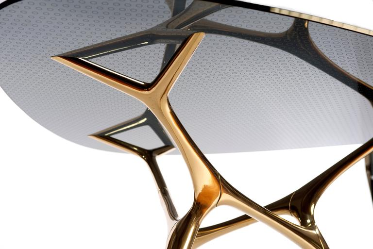 Contemporary E-Volved Table in Polished Bronze and Etched Glass In Excellent Condition For Sale In Philadelphia, PA