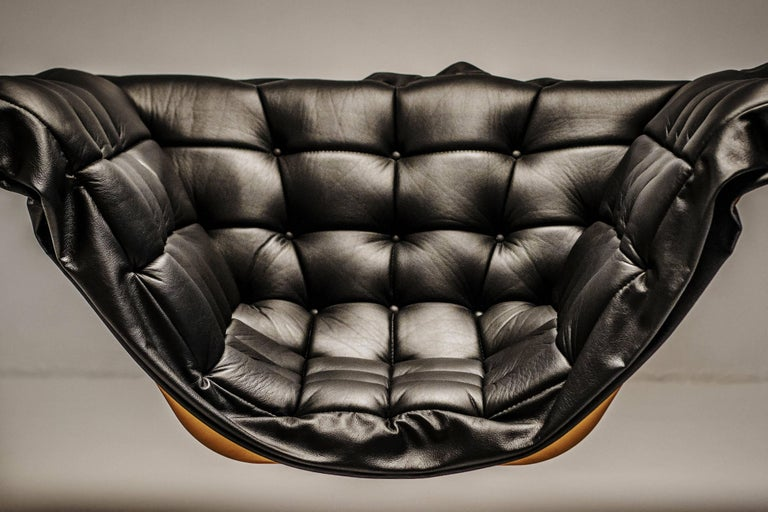 Orbital armchair was designed by Parisian design studio Harow. The sleek bronze skeletal structure and leather upholstery is a classic coupling of luxury materials with an edgy and industrial design. It is a limited edition piece that can also be