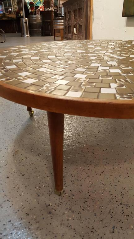 A Gordon & Jane Martz circular mosaic tile coffee table for Marshall Studios, circa 1960s. Solid walnut frame and conical