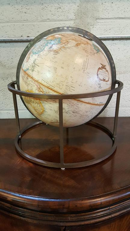 Tabletop world globe with square tubular brass stand by Replogle. Attributed to Paul McCobb, circa 1960s. Nice patina to metal base, globe in excellent condition.