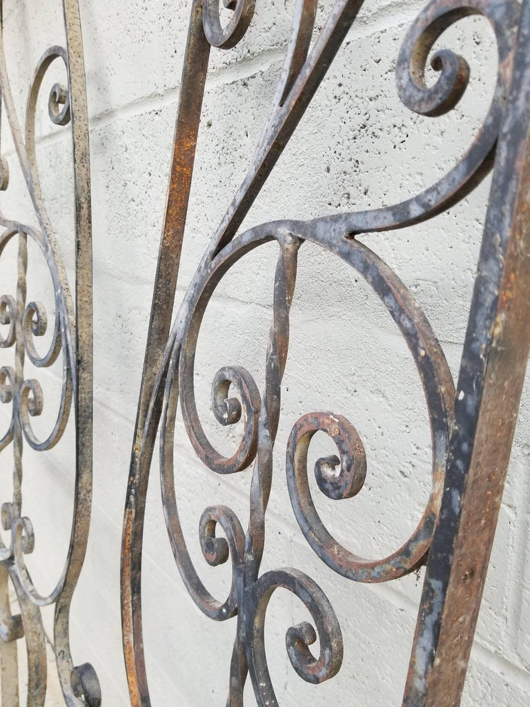 A pair of vintage wrought iron architectural pieces. Nice workmanship in this opposing pair of panels. Measurements do not include 9.5