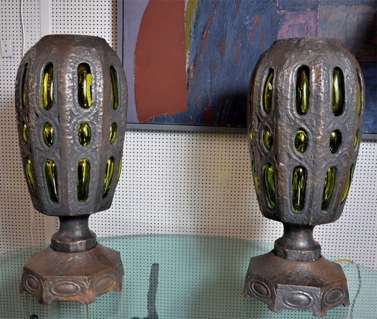 Very unique pair of bronze and glass lamps.