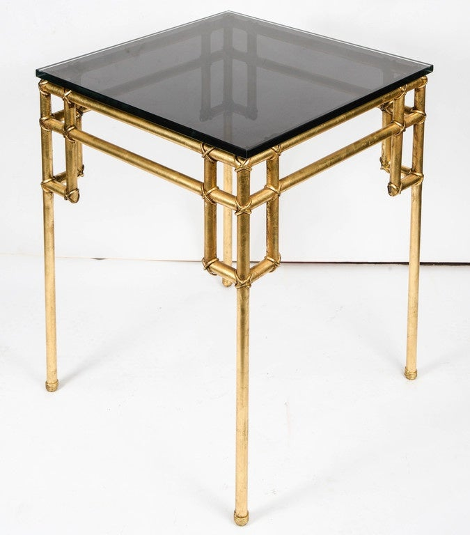 Pair of gilt metal table in the style of Baguès.