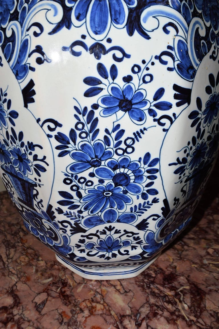 Pair of blue and white delft ginger jars vases base marking at highly decorative blue and white ginger jars in the delft manner floral design all around reviewsmspy