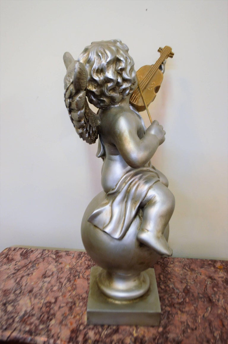 Plaster Pair of Silver Ornamental Musician Cherub Sculptures For Sale