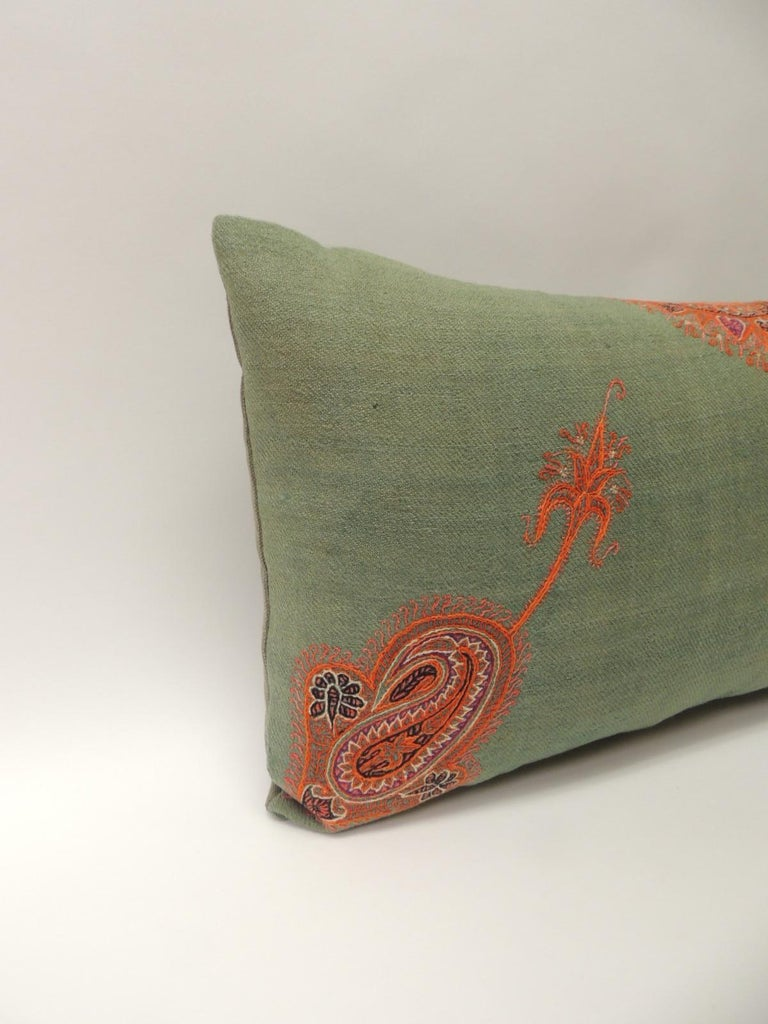 Pair of 19th century Paisley embroidery Persian long bolsters pillows Antique Persian embroidered long bolster decorative pillows. Textiles on accent pillow embellished with silk threads embroidered onto green wool. Throw pillows enhanced with a