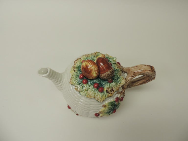The cover depicts mushroom and acorn. Hand painted (never used) have paper label still attached. The basket weave pattern body is embellished by tromp l'oeil berries and branches. Fitz and Floyd white bone China 40 OZ. U.S.A. 1981 Fitz and Floyd