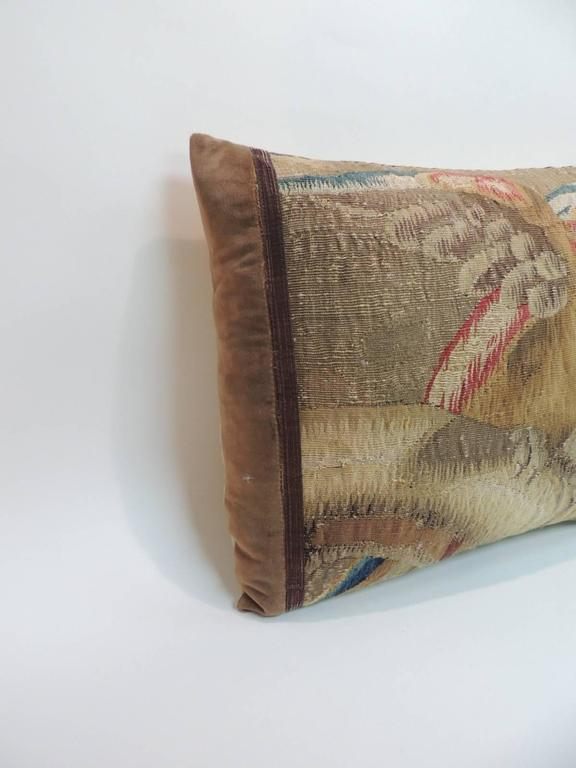 Antique Aubusson tapestry pillow depicting baby macaw in shades of red, yellow, blue and tan. Antique copper metallic trim framing the tapestry and antique brown silk velvet. Golden silk backing. Pillow hand-made and designed in the USA. Closure by