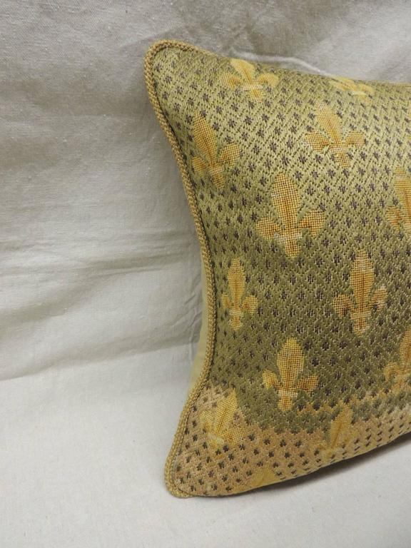 Antique textile fleur de lis embroidery tapestry pillow with wool and silk. Encrusted metallic threads. Golden silk backing and gold metallic rope trim all around.  Throw pillow hand-made and designed in the USA.  Closure by stitch (no zipper) with
