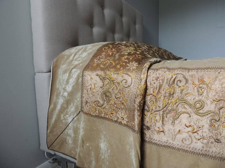 19th century Chinese embroidered bedcover., Dragons and flowers embroidered with gold metallic threads onto silk and silk velvet. Antique metallic trims embellish the borders of the bed cover. Lining in new cotton fabric.  Fits a queen and a king