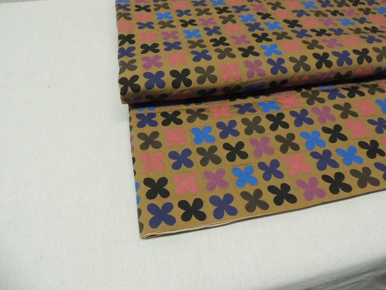 "Offered by the Antique Textiles Galleries: Antique Japanese quilted blanket. Large colorful ""quatrefoil"" pattern blanket, hand-stitched details around each quatrefoil. Lined in a tan antique cotton in shades of blue, brown, red, purple and"