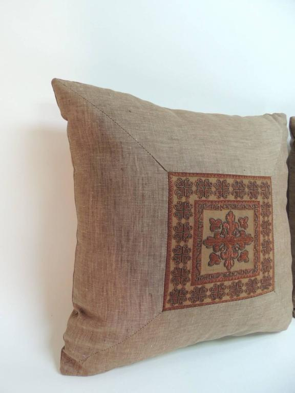 """Pair of 19th century Persian decorative pillows with silk threads embroidered on sheer tulle and framed with textured brown vintage linen same as backing. The center embroidered square, (6.5"""" by 6.5"""" measurement) depicts a stylized fleur de lis"""