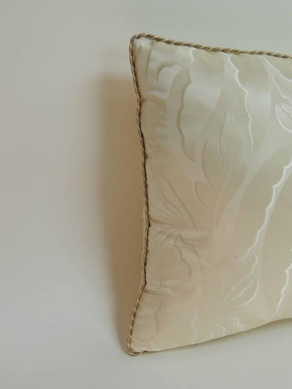 Antique silk ecru decorative lumbar pillows with cream silk backing and embellished with a small rope decorative inspired silk trim. A damask pattern with a Mid-Century twist. Decorative lumbar pillows handcrafted and designed in the USA with