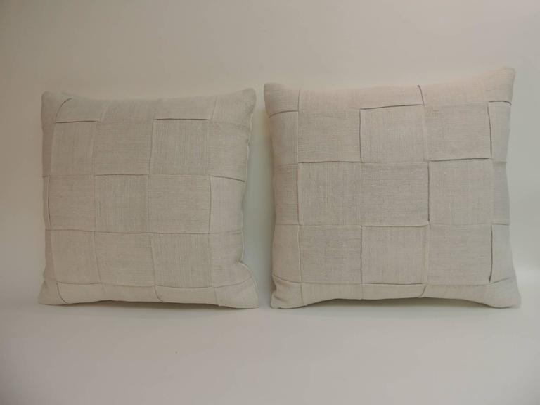 Pair of 19th century homespun French linen pillows Pair of 19th century homespun French textured linen decorative pillows in oatmeal and natural. Exclusive Atelier Lam basket weave design. 19th century homespun decorative French pillows finished